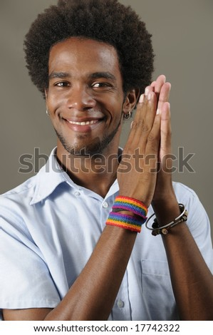 Portrait of young positive african male model with pleased expression - stock photo