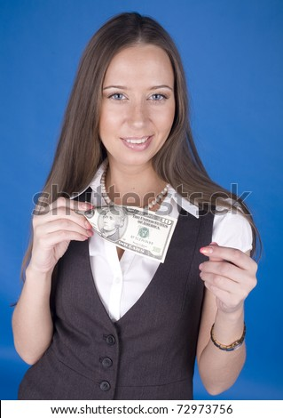 portrait of young pretty businesswoman with dollars