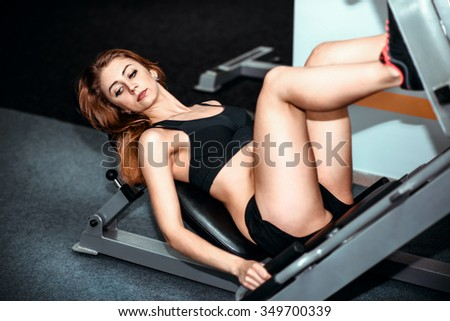 Portrait of young pretty girl training in the gym