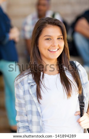 portrait of young pretty highschool student - stock photo