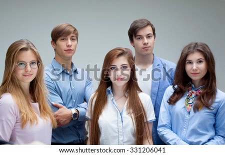 Portrait of young pretty smiling students