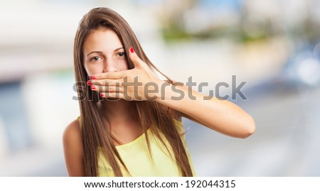 portrait of young pretty woman doing a censure gesture - stock photo