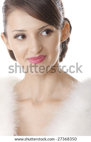Portrait of young pretty woman in fur coat over white background