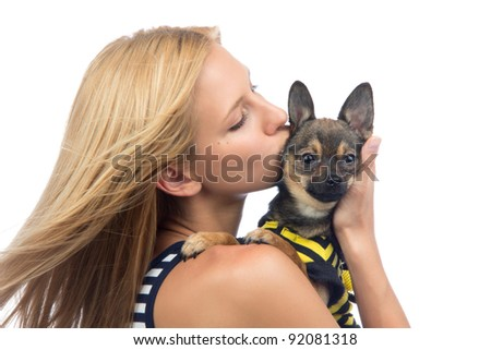 Portrait of young pretty woman kissing small Chihuahua puppy dog isolated on a white background