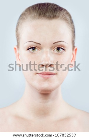 Portrait of young pretty woman on white background