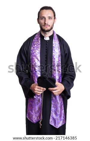 Portrait of young priest. Studio portrait isolated on white background   - stock photo