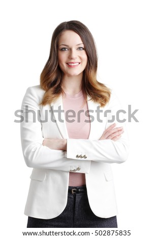 Portrait of young professional woman with arms crossed standing at isolated background.