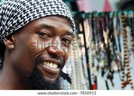 portrait of young rasta man in the craft market - stock photo