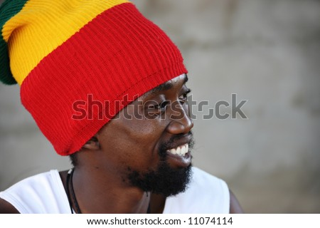 portrait of young rasta man in traditional clothes - stock photo