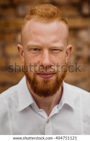 portrait of young red hair man with beard vertical