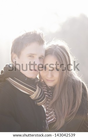 portrait of young relaxing caucasian couple standing together outdoor - stock photo