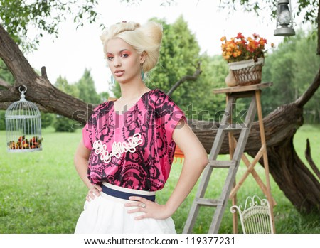 Portrait of young romantic woman on a picnic in a fairy forest. Outdoors. - stock photo