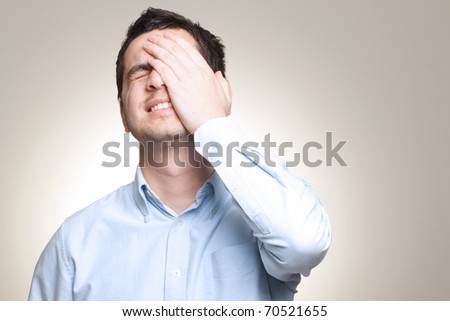 Portrait of young sad man worrying or having pain - stock photo