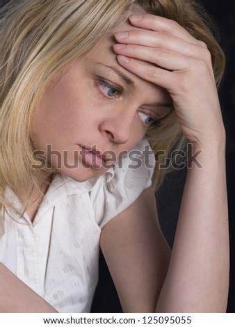 portrait of young, sad women - stock photo