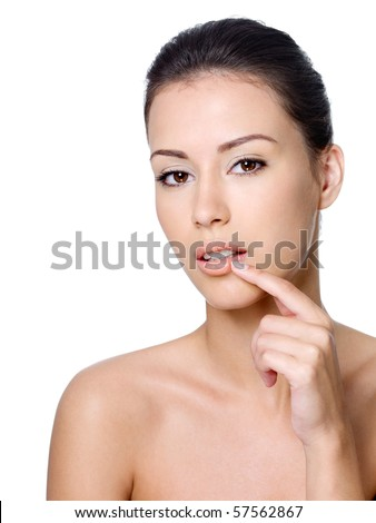 Portrait of young sensual beautiful woman touching her lips - isolated - stock photo