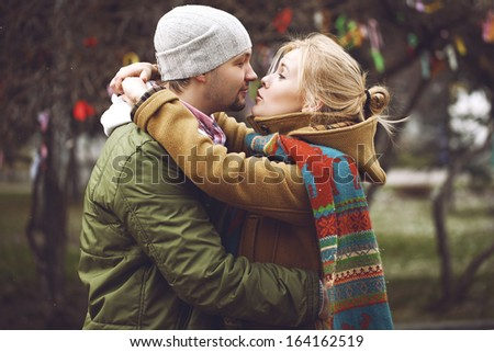 portrait of young sensual couple in autumn wather. love and kiss - stock photo
