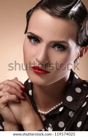 Portrait of young, serious and beautiful woman in vintage image