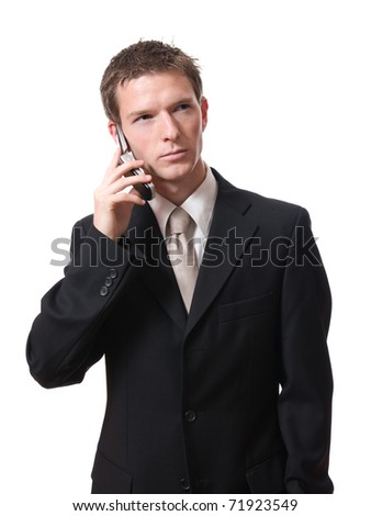 portrait of young serious businessman talking with cellphone isolated on white background - stock photo