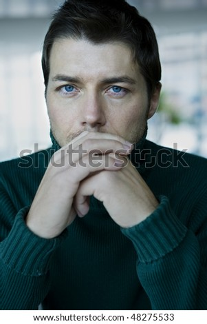 Portrait of young serious man, close-up - stock photo