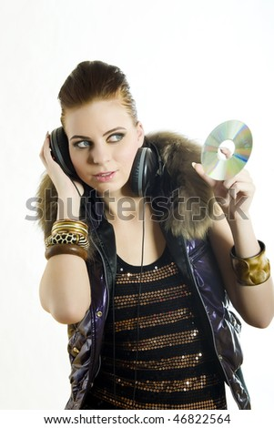 Portrait of young sexy party girl with headphones listening to the disco music. isolated on white background