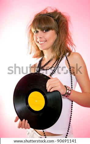 Portrait of young sexy woman dancing with vinyl disc