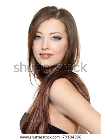 Portrait of young sexy woman with long hair posing on white background