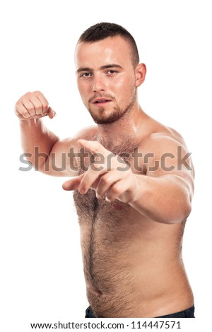 Portrait of young shirtless male fighter pointing at you, isolated on white background. - stock photo