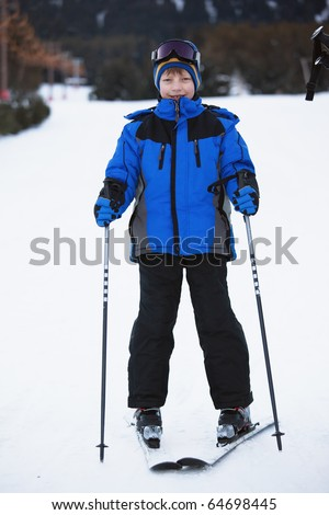 Portrait of young skier on ski slope - stock photo