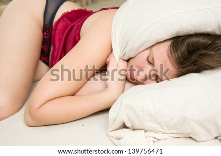 portrait of young sleeping woman - stock photo