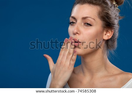 Portrait of young sleepy female yawning isolated with copy-space - stock photo