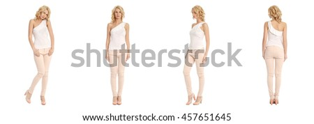 Portrait of young slim woman in beige pants posing isolated on white background