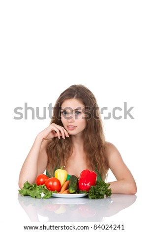 Portrait of young smile beautiful woman eating raw vegetables salad, sitting at the table, isolated over white background - stock photo