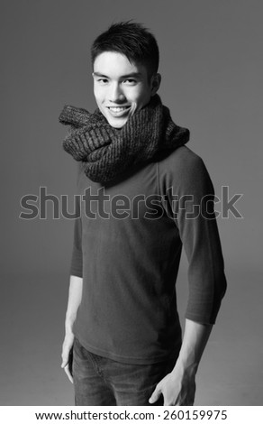 portrait of young smile man with scarf -black and white - stock photo