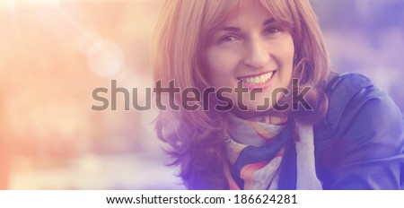 portrait of young smiling and happy woman close up, with sunlight effect