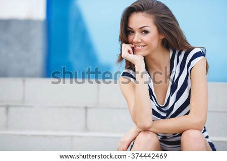 Portrait Of Young Smiling Beautiful Woman. Close-up portrait of a fresh and beautiful young fashion model posing outdoor. Summer outdoor portrait - stock photo
