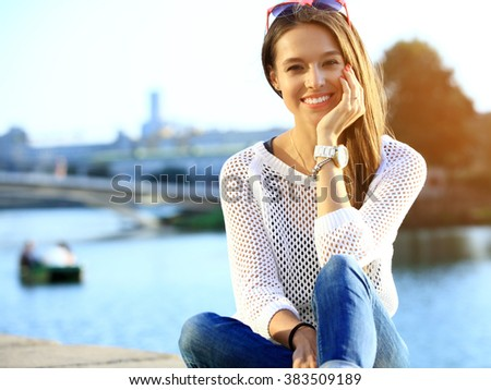 Portrait Of Young Smiling Beautiful Woman. Close-up portrait of a fresh and beautiful young fashion model posing outdoor. Summer outdoor portrait