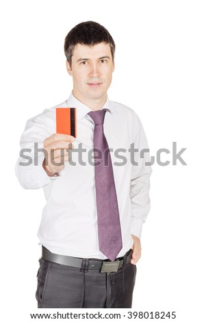 portrait of young smiling business man holding credit card.  isolated on white background. technology, shopping, banking and lifestyle concept - stock photo