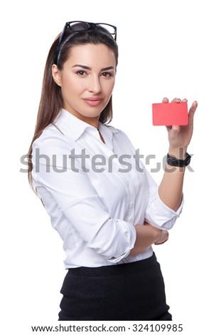 Portrait of young smiling business woman showing credit card, isolated on white background