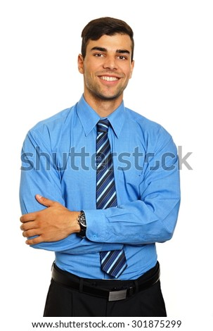 Portrait of young smiling businessman in blue shirt on white background