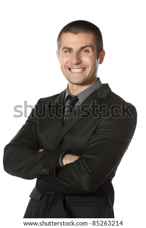Portrait of young smiling businessman standing with folded hands isolated on white background - stock photo