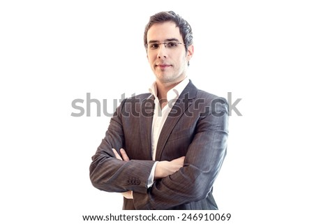 Portrait of young smiling businessman wearing business suit and glasses with crossed arms in front of the body. Isolated over white background. - stock photo