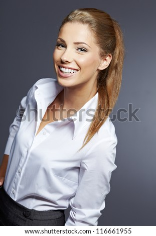 Portrait of young smiling businesswoman - stock photo