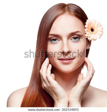 portrait of young smiling caucasian red haired woman with flower in hair isolated on white - stock photo