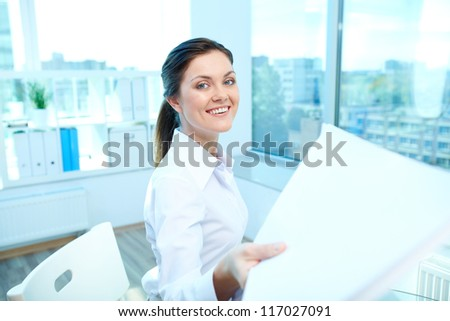 Portrait of young smiling female giving application to conductor - stock photo