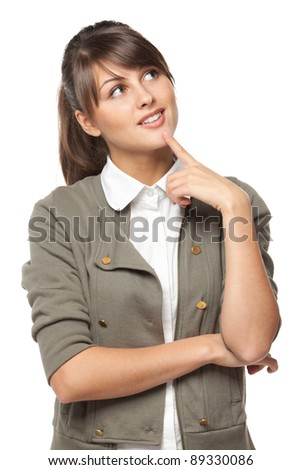 Portrait of young smiling female standing with folded hands looking up, over white background - stock photo