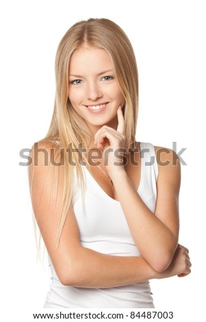 Portrait of young smiling female standing with folded hands over white background