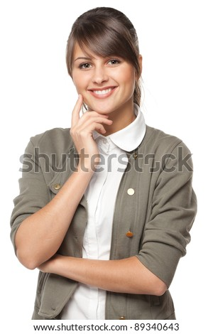 Portrait of young smiling female standing with folded hands, over white background - stock photo