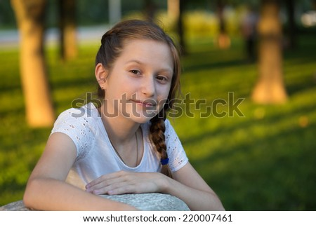 portrait of young smiling girl outdoors  - stock photo