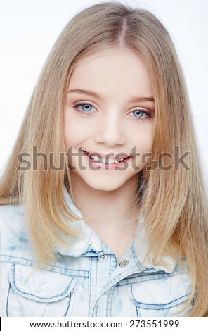 Portrait of young smiling girl with blue eyes. Isolated on white - stock photo