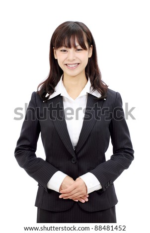 Portrait of young smiling japanese business woman with hands crossed - stock photo